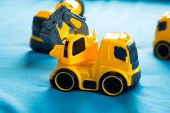 Children`s toy yellow tractor Stock Photography