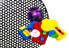 Children's   toys. Children's toys on an iron black lattice Stock Photos