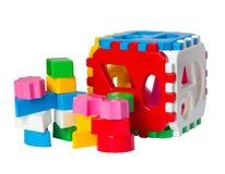 Children's  toys. Children's colour toys on white Royalty Free Stock Photos