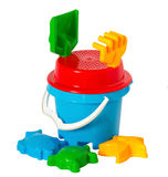 Children's toys. Children colourful bucket and toys on white Stock Images