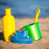 Children`s toys at the beach. Children`s toys for sand and sunblock lotion at the beach Royalty Free Stock Image