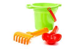 Children's toys  bucket  shovel and  rake on the white Royalty Free Stock Photos