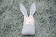 Toy rabbit on a fluffy patch on Easter backround. Children `s toys look great like easter decoration and give a fun atmosphere in the house stock photos
