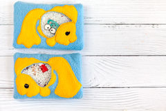 Children's toys made of colored fleece for motor development. Bag with yellow fish filled plastic beads and figurines Royalty Free Stock Images