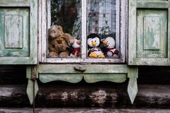 Children`s toys on the old village window royalty free stock photo