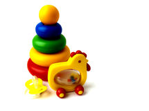 Children's toys a pyramid a chicken a dummy Royalty Free Stock Photos