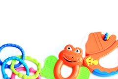 Children`s toys rattle in the form of a frog, a ship and chains stock image