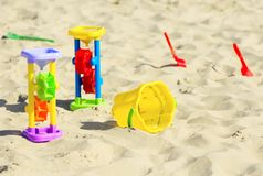 Children`s toys on the sand Stock Photos