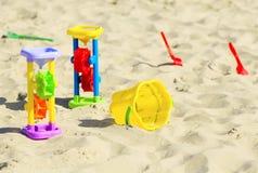 Children`s toys on the sand Stock Photos