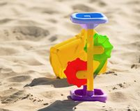 Children`s toys on the sand Royalty Free Stock Photo