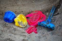 Children's toys on the sand Stock Images
