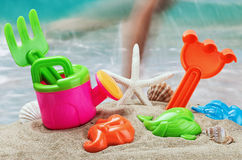 Children's toys in the sand on the beach Stock Photos