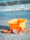 Children`s toys in the sand/ Close up Stock Photos