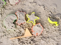 Children's toys in the sand. Royalty Free Stock Photos