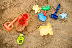 Childrens toys in the sand Stock Images