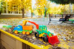 Children`s toys in the sandbox close-up Stock Photos