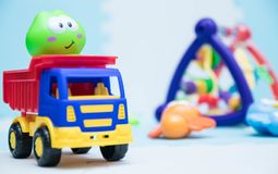 Children`s toys. A small machine close-up for children. playing mat with children`s toys. horizontal background with children`s stock image