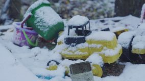 Toys under the snow. Children`s toys under the snow hd stock video