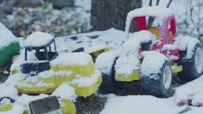 Toys under the snow. Children`s toys under the snow hd stock footage