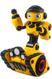 Children's toys - yellow robot on caterpillar wheels stock photography