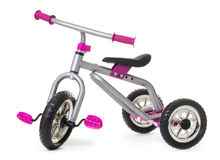 Children's tricycle pink bicycle Royalty Free Stock Photo