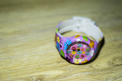 Children`s watch with multicolored strap Royalty Free Stock Images