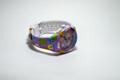 Children`s watch with multicolored strap Royalty Free Stock Image