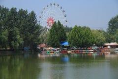Children`s water park. Ferris wheel. A children`s paradise built on a quiet lake. zhaofuxin 2017.9 stock photo