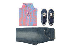 Children's wear - jeans, summer shirt and sneakers on white. Background from above Stock Photos