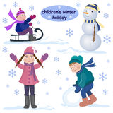 Children's winter holiday. The girl in winter coat standing with his hands up, the boy in the parka making a big snowball, the boy riding on a sled. The Stock Photography