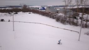 Aerial photography competitions on a mountain slalom stock footage