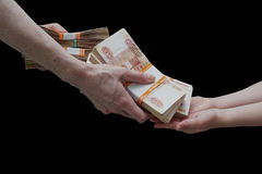 Children's and woman's hand with stack of Russian money Stock Photos