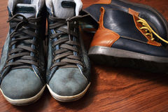 Children`s and women`s shoes on a wooden background Stock Photography