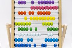 Children`s wooden abacus on an white background royalty free stock photos