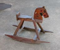 A childrens antique wooden rocking horse Stock Image