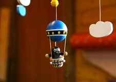 Children`s wooden toy `Mole balloonist`. New Year`s decor. Festive mood. Moscow Stock Images