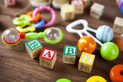 Children`s World toy on a wooden background. Stock Photo