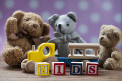 Children`s World toy on a wooden background. Stock Photos