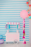 Children`s zone with sweets: lollipops, ice cream, macarons, balloon and candy bar. Children room with blue stripe Royalty Free Stock Photos