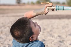 Children are sad to have no water to drink. Children are sad to have no water to drink in the water shortage Stock Photography