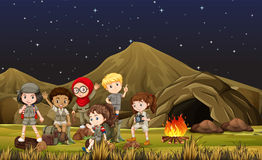 Children in safari costume camping out by the cave Royalty Free Stock Photography