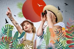 Children in safari costumes and hats pointing and looking in binoculars at birds. And cactuses stock illustration