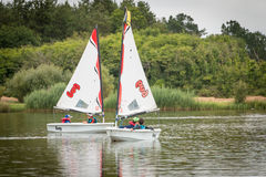 Children sailing boat. Bretignolles sur Mer, France - June 28, 2016 : Children sailing on boats on a lake Stock Photos