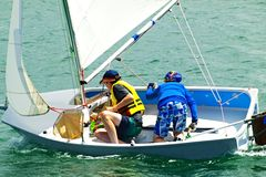 Children sailing boat pictures. Children having fun sailing. Sailboat pictures Lake Macquarie, New South Wales, Australia Stock Image