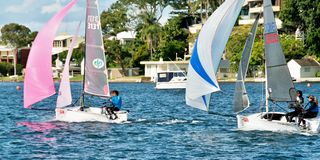 Children sailing competition in dinghies. stock images