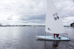 Children, sailing in the high school sailing Championships. New stock photos