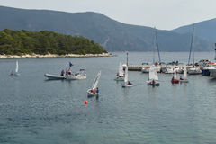 Children sailing school. Fiskardo, Greece - October 2, 2016: Children sailing school in the bay of Fiskardo, Kefalonia Island. Coaches instruct group of kids on Stock Photo