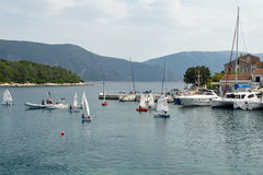 Children sailing school. Fiskardo, Greece - October 2, 2016: Children sailing school in the bay of Fiskardo, Kefalonia Island. Coaches instruct group of kids on Stock Photography