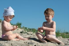 Children on sand Stock Image