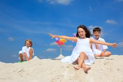 Children in sand on beach. Children having fun playing in the sand on a beach on a bright summer day Stock Photos